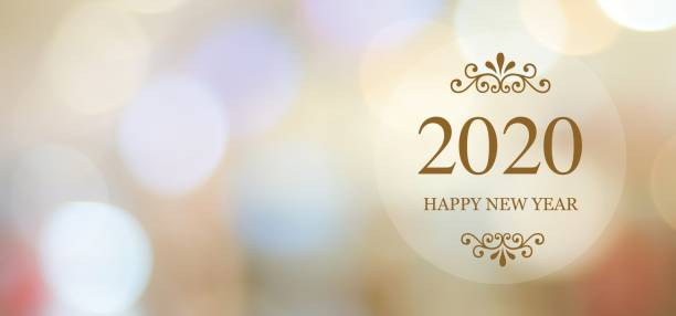 Happy New Year 2020 on blur abstract bokeh background with copy space for text, new year greeting card, banner stock photo