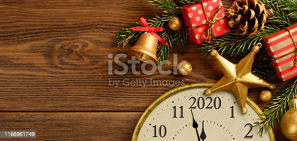 istock Happy new year 2020. Retro style clock with christmas decorations. 1168961749