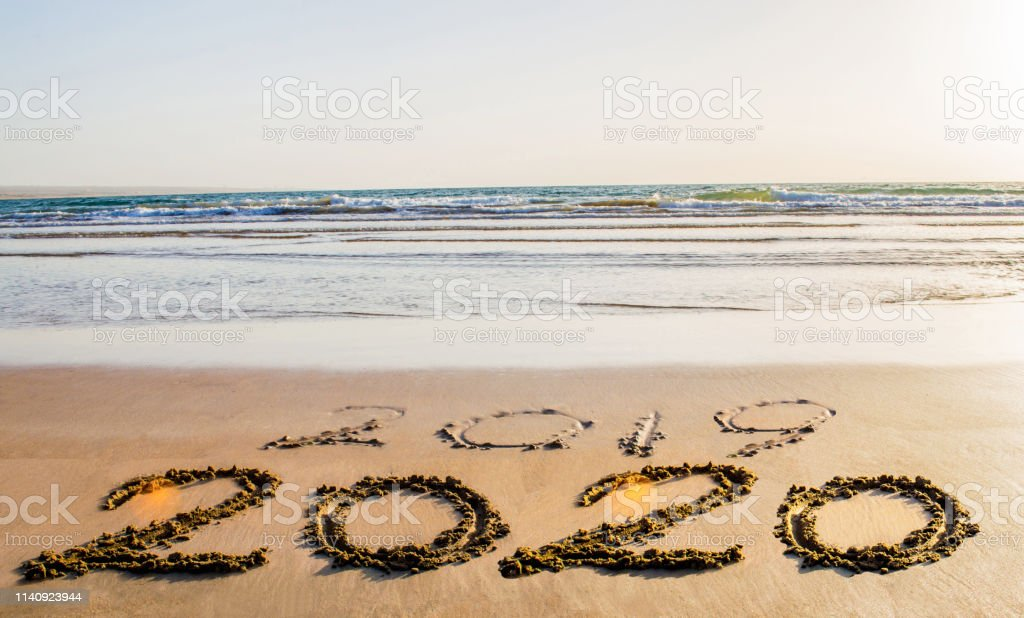 Happy New Year 2020 Text On The Sea Beach Abstract Background Photo Of Coming New Year 2020 And Leaving Year Of 2019 Stock Photo Download Image Now