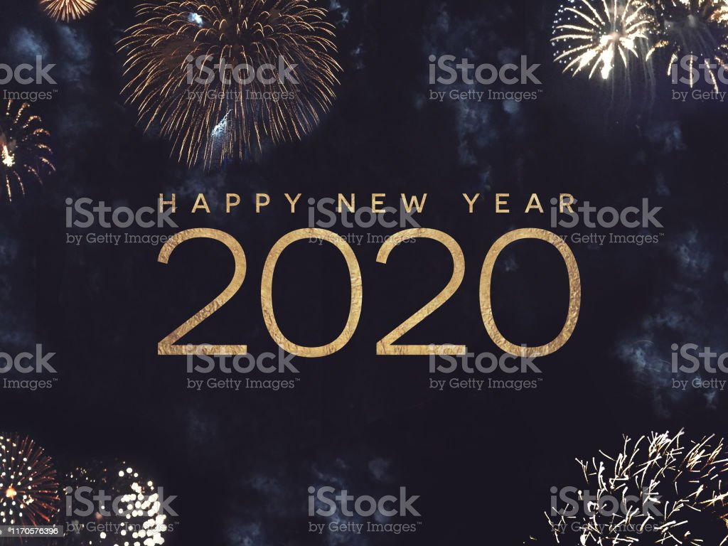 Happy New Year 2020 Text with Gold Fireworks in Night Sky Happy New Year 2020 Text Holiday Graphic with Gold Fireworks in Night Sky 2020 Stock Photo