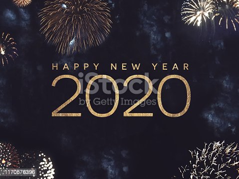 istock Happy New Year 2020 Text with Gold Fireworks in Night Sky 1170576396