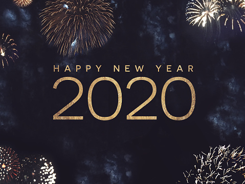 Happy New Year 2020 Text With Gold Fireworks In Night Sky Stock Photo - Download Image Now