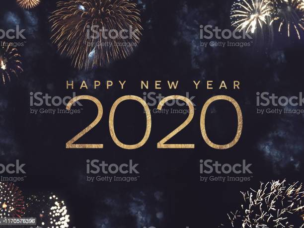 Happy New Year 2020 Text With Gold Fireworks In Night Sky - Fotografias de stock e mais imagens de 2020