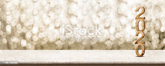 istock Happy New Year 2020 wood with sparkling star on marble table with gold bokeh background,Holiday festive celebration concept.Banner mock up for display of product or design content 1166736998