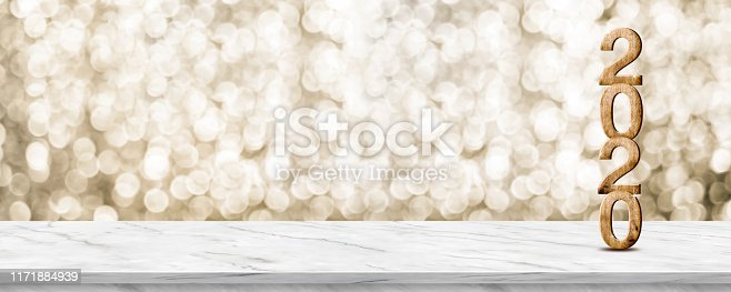 istock Happy New Year 2020 wood with sparkling star on marble table with gold bokeh background,Holiday festive celebration concept.Banner mock up for display of product or design content 1171884939