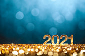 istock Happy New Year 2021 - Christmas Gold Blue Glitter 1281657485