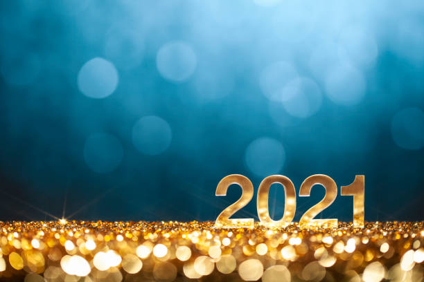 Happy New Year 2021 - Christmas Gold Blue Glitter Golden numbers 2021 on glitter and defocused lights. 2021 stock pictures, royalty-free photos & images