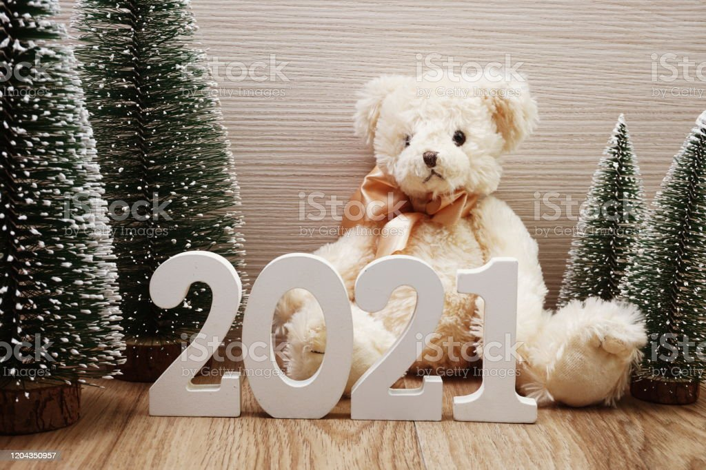 Christmas Tree Recolection 2021 Happy New Year 2021 Festive Background With Christmas Tree And Teddy Bear Decoration On Wooden Background Stock Photo Download Image Now Istock