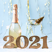 Happy New Year 2021 . Festive Shining postcard.Champagne bottle gold composition.