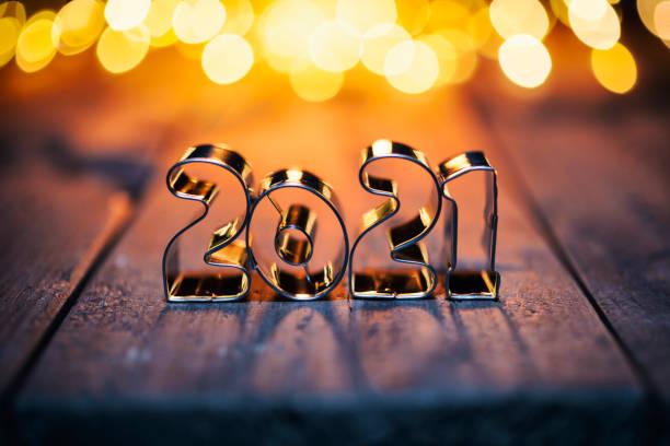 Happy New Year 2021 - Gold Metal Lights Wood Defocused Christmas stock photo