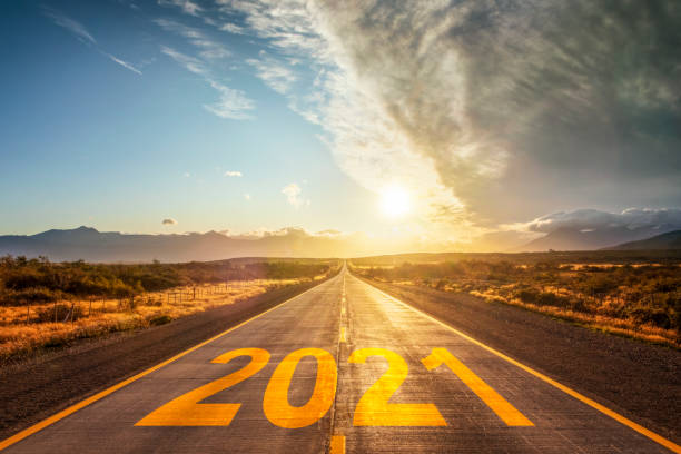 Happy New Year 2021 new year at beautiful empty highway at sunset stock photo