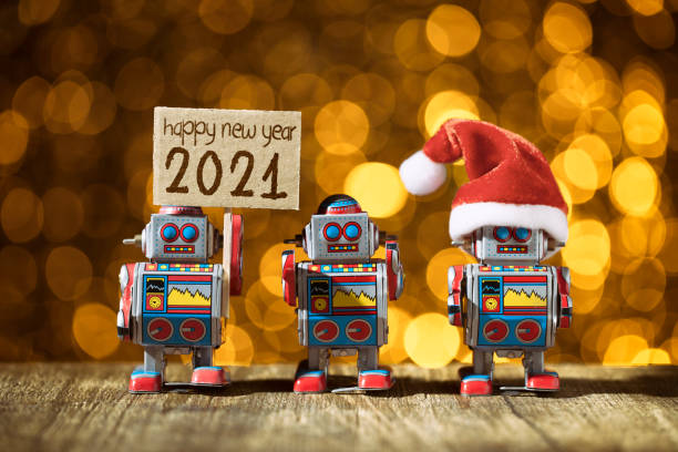 Happy New year 2021. Three retro robots posing for Holidays - Christmas Santa Fun Humor stock photo