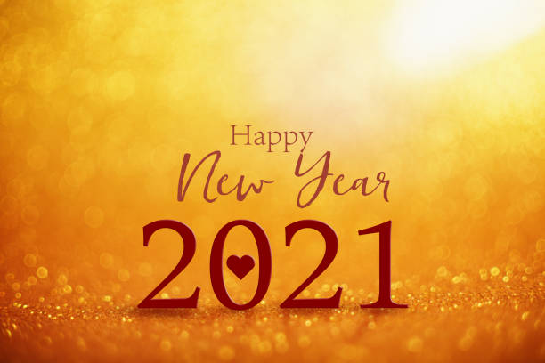 Happy New Year 2021 with love greeting on gold colored bokeh balls at the background stock photo
