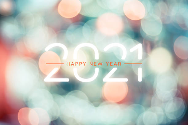 Happy new year 2021 with pastel orange and light green bokeh light sparkling background,Holiday celebration greeting card stock photo