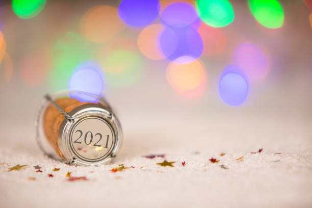 Happy New Year 2021 with Star Shape and Cork on the Snow stock photo