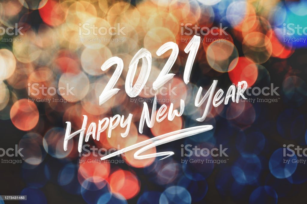 2021 happy new year brush stroke handwriting on abstract festive colorful bokeh light background,holiday greeting card - Royalty-free 2021 Foto de stock