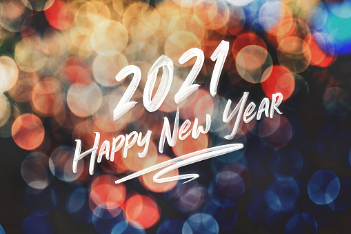 2021 happy new year brush stroke handwriting on abstract festive colorful bokeh light background,holiday greeting card