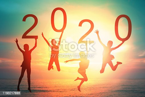 Happy new year card 2020 retro or lomo style. Silhouette of children girl  jumping on tropical beach with vintage sunset sky background. Kids holding the number 2020 with sea and sunrise background.