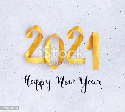 845307398istockphoto Happy New Year card 2021 with bright golden numbers on concrete background 925708764