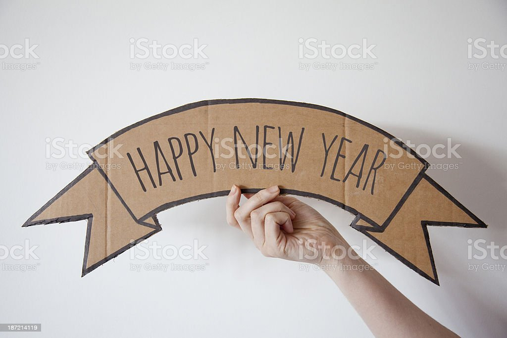 Happy new year cardboard banner royalty-free stock photo