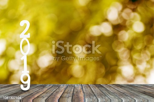 istock Happy new year celebration wooden cut number 2019 on top of wood table. 1081307104