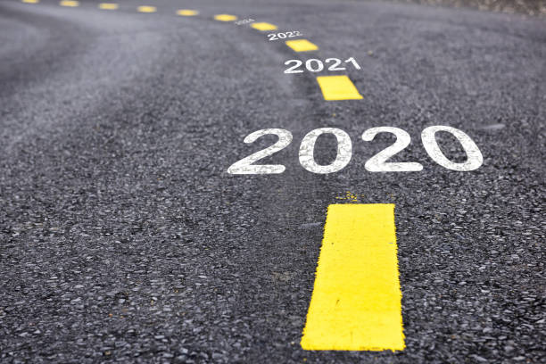 2020 happy new year concept Number of 2020 to 2022 on asphalt road surface with marking lines modern period stock pictures, royalty-free photos & images
