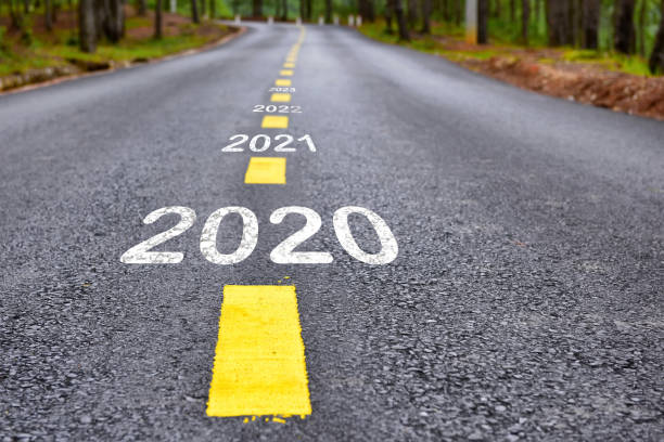 2020 happy new year concept Number of 2020 to 2022 on asphalt road surface with marking lines the way forward stock pictures, royalty-free photos & images
