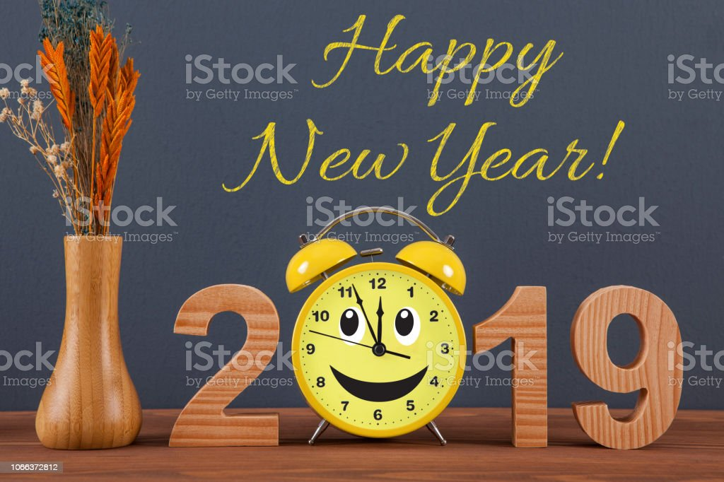 Happy new year concepts 2019 countdown clock on wooden table