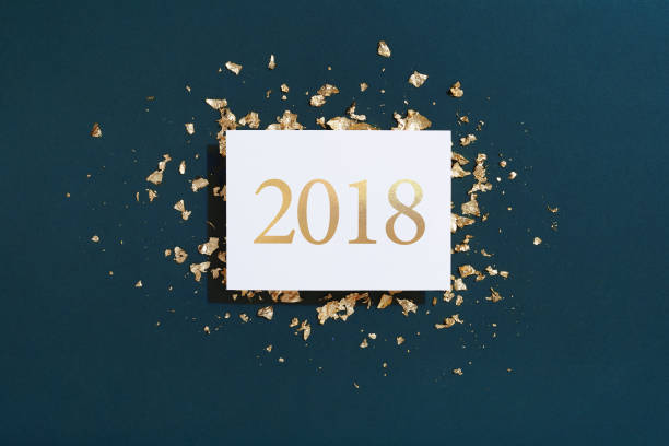 Happy New Year gold color 2018 number greeting card on blue background, gold foil decoration stock photo