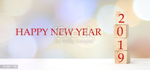 1009979852 istock photo 2019 happy new year greeting card, Wooden cubes with 2019 and Happy new year celebration over blur bokeh background, Happy new year banner 1018571190