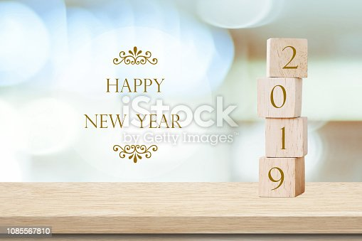 1009979852 istock photo 2019 happy new year greeting card, Wooden cubes with 2019 and Happy new year celebration over blur bokeh background, Happy new year banner 1085567810
