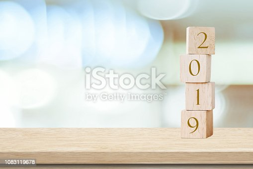 1009979852 istock photo 2019 happy new year greeting card, Wooden cubes with 2019 over blur bokeh background with copy space for text, Happy new year banner 1083119678