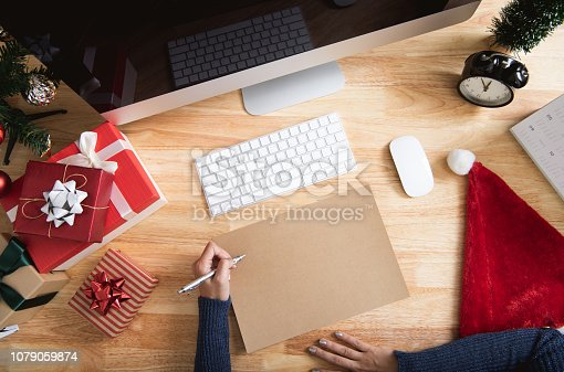 1073023470 istock photo Happy new year holiday greeting paper card design mockup with decoration on wood table. 1079059874
