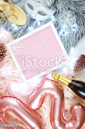 istock Happy New Year hygge style flatlay with rose gold balloons and letter board. 1181929172