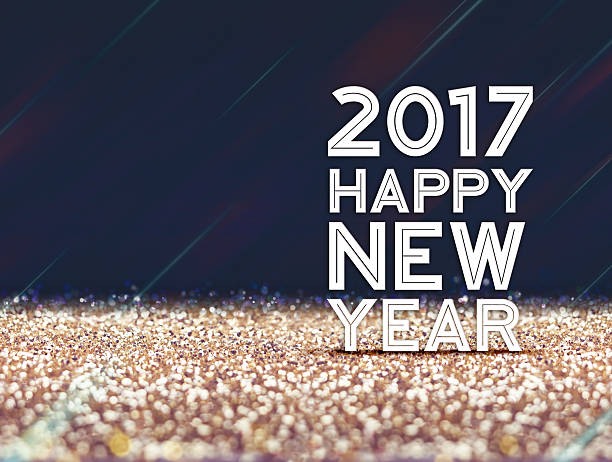 2017 Happy New year in gold and dark purple  glitter stock photo