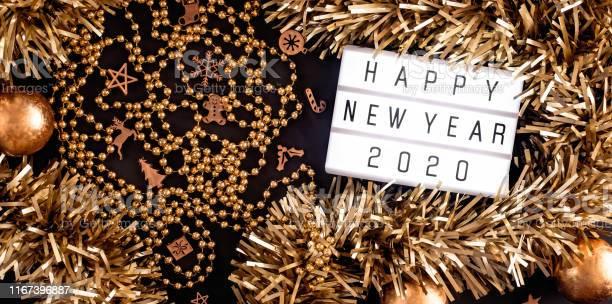 Happy new year lightbox on black table backgroundtop view of party picture id1167396887?b=1&k=6&m=1167396887&s=612x612&h=sdzbvzgjlaxnfbecffrjnmmmwgy4fdbu7ojn u5qa9e=