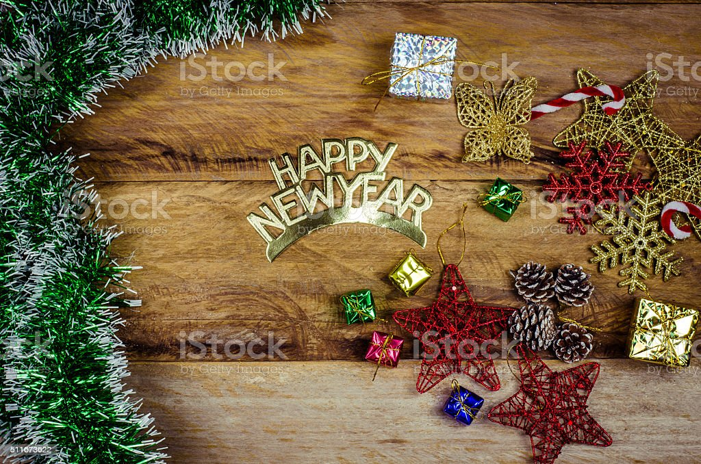 Happy New Year message and gift box on wooden background. stock photo