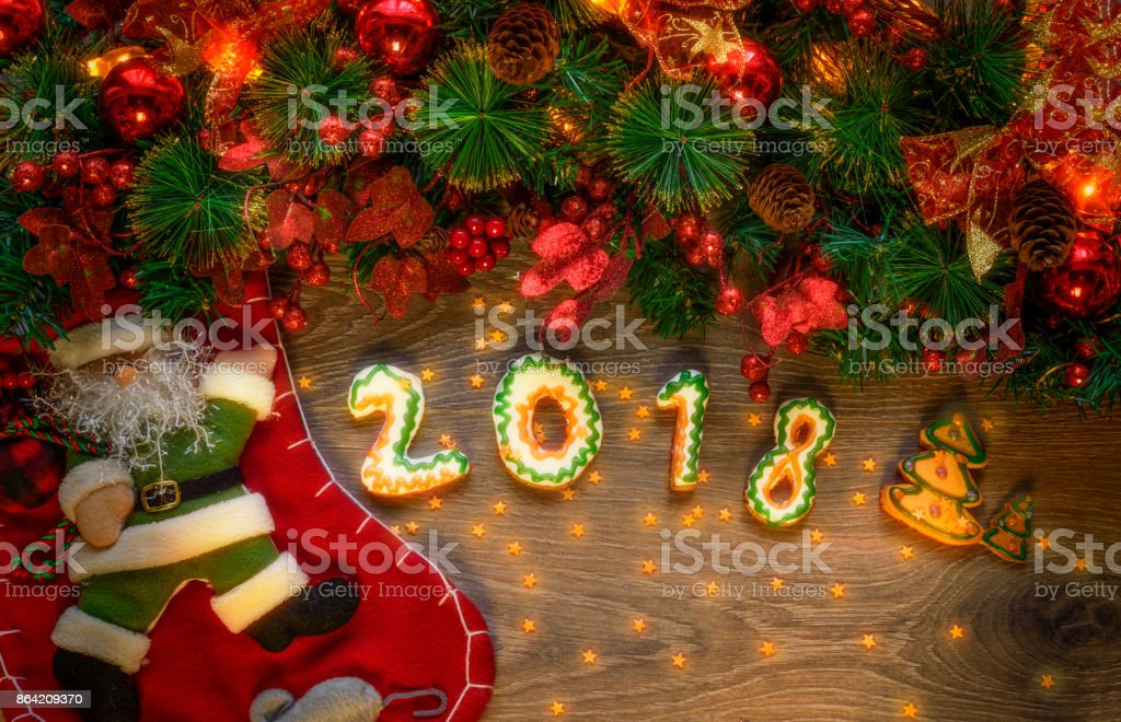 Happy New Year message, Christmas cookies in shape numeral royalty-free stock photo