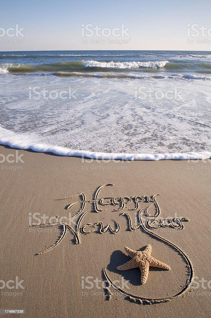 Happy New Year Message Handwritten Starfish on the Beach stock photo