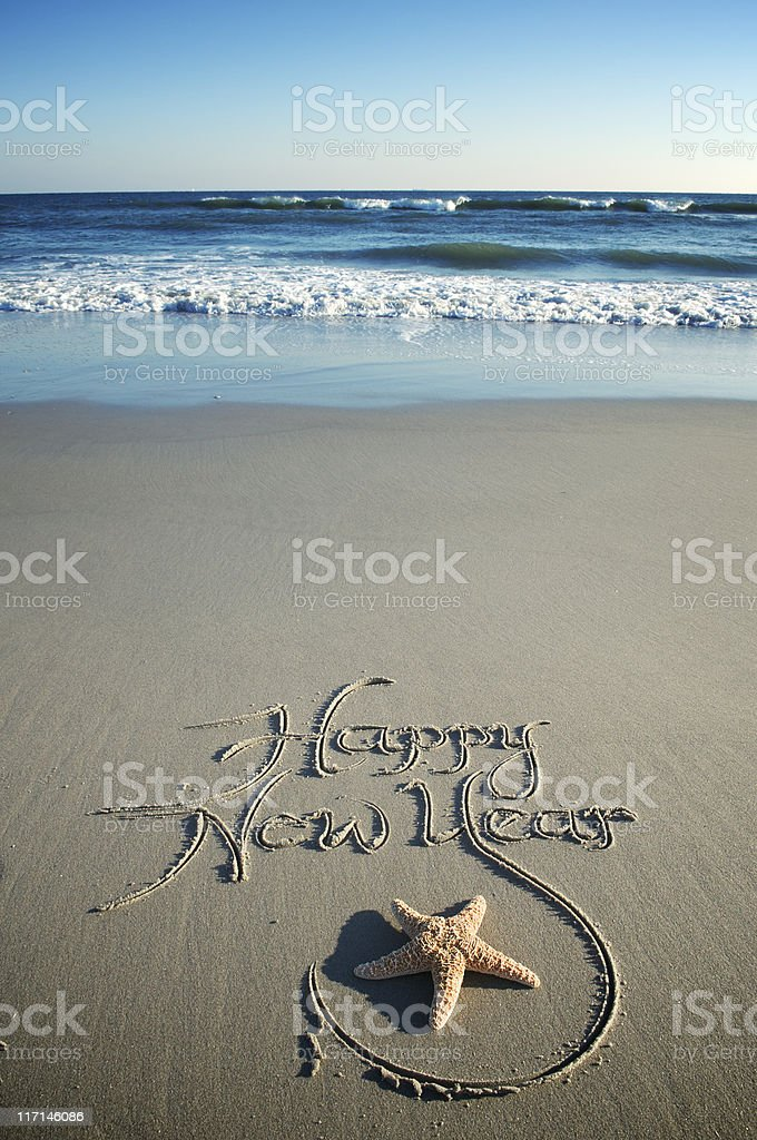 Happy New Year Message w Starfish on Smooth Beach  Beach Stock Photo