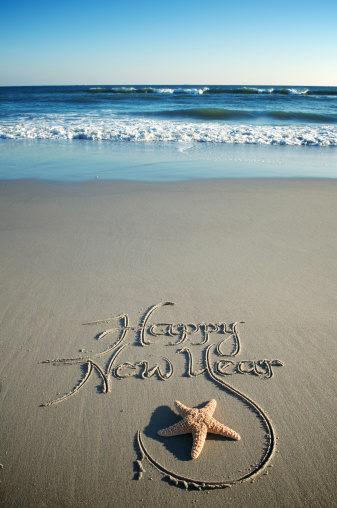 Happy New Year Message W Starfish On Smooth Beach Stock Photo - Download Image Now