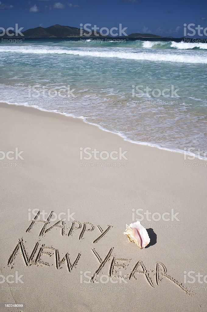 Happy New Year Message with Shell on Tropical Beach royalty-free stock photo