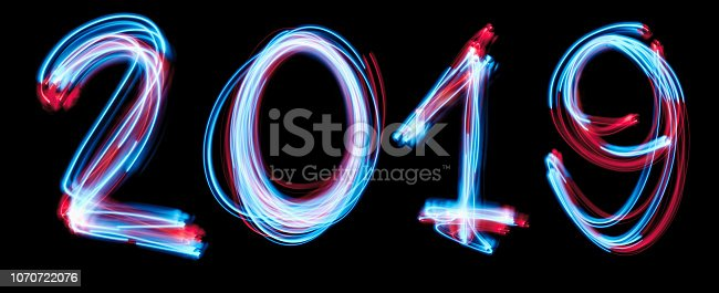 istock 2019 happy new year number with neon lights backgrorund. 1070722076