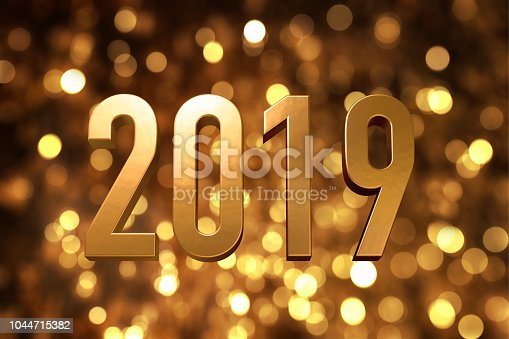 istock 2019 happy new year number with sparkling gold bokeh backgrorund 1044715382