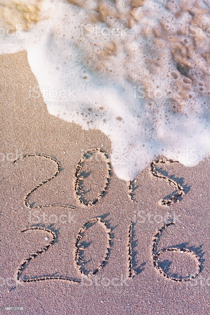 Happy New Year numbers 2016 2015 on the sea beach stock photo