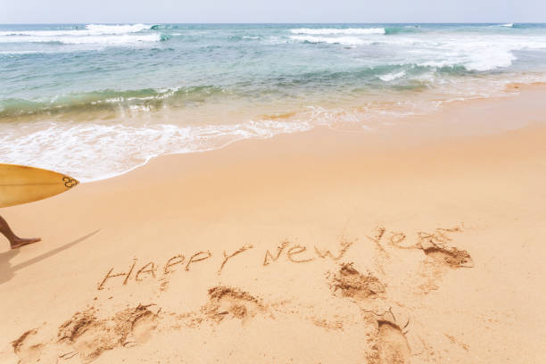 happy new year on the beach stock photo istock
