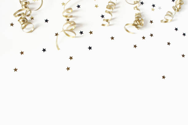 happy new year or birthday festive composition. golden confetti and glittering stars on white table background. celebration, party concept. flat lay, top view. empty copy space. - new year imagens e fotografias de stock