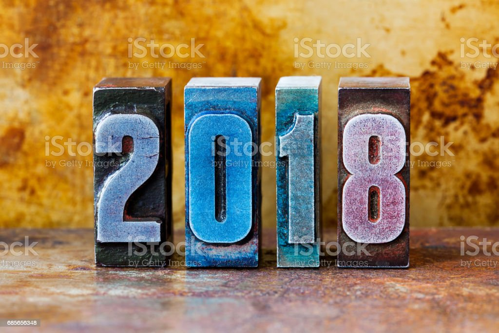 2018 happy new year postcard. Colorful letterpress digits symbol winter holidays. Creative retro style design xmas poster. Shallow depth field foto de stock royalty-free