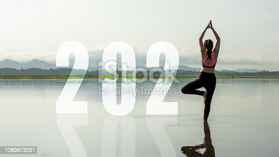 Happy new year start up 2021.  Yoga women lifestyle exercise and pose for healthy life. people balance body vital zen and meditation for workout sunrise morning nature background for success 2012. Health care Concept