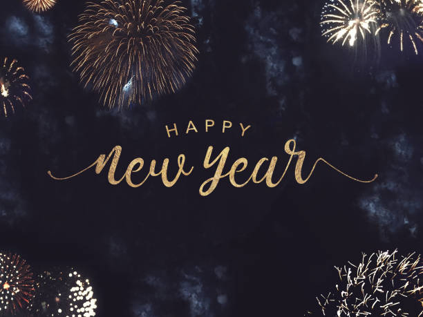 happy new year text with gold fireworks in night sky stock photo